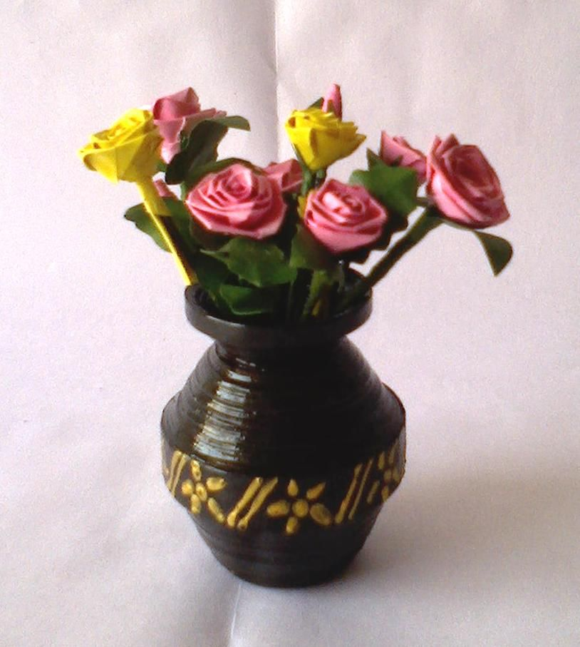 This flower pot is made with waste xerox paers cut into for Flower pot out of waste material