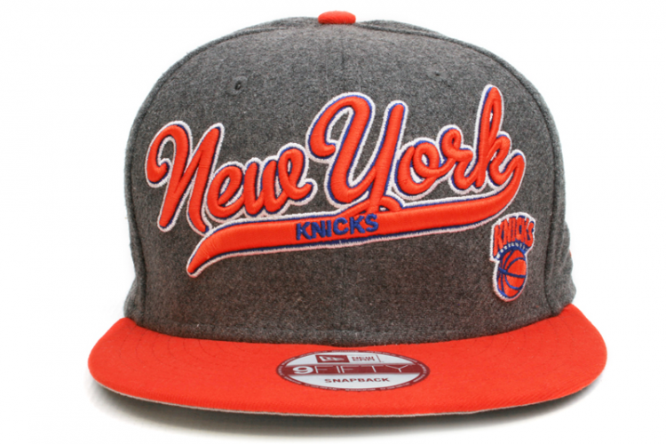 NEW ERA New York Knicks Scripter 2 9Fifty Snapback    Grey / Orange / Blue / White    This 9FIFTY cap features an embroidered (raised) New York Knicks script team namesake at front, a stitched New Era flag at wearer's left side, and a stitched team logo at wearer's right side. A snapback closure for an adjustable fit. Interior includes branded taping and a moisture absorbing sweatband.  New Era flag may vary in color with the image featured on site.    100% Wool.
