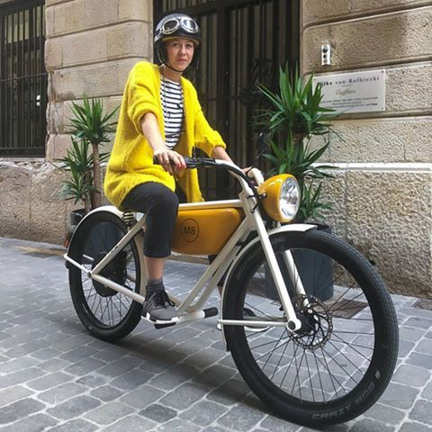 She got the look on her new M8 electric moped!