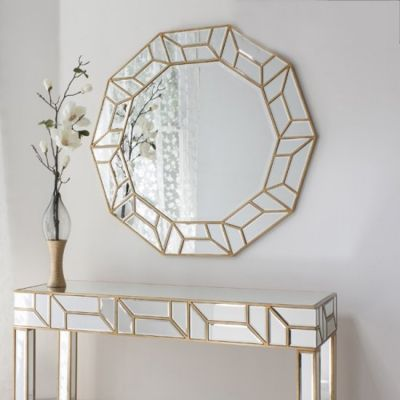 Round glass framed gold trim mirror with matching mirrored console