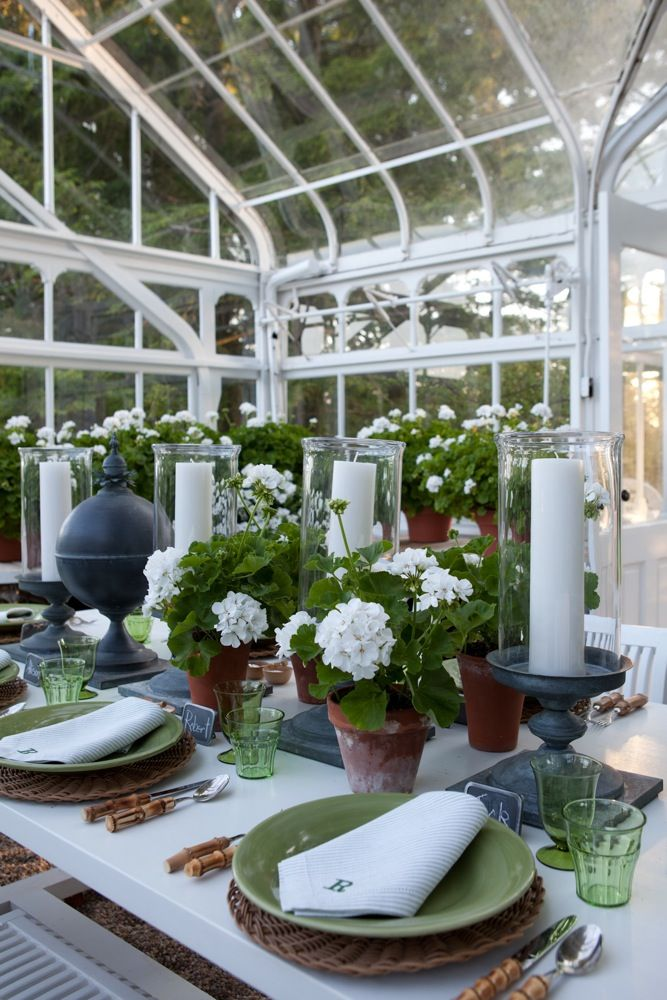 Geraniums, finials, and monogrammed napkins... Lovely Greenhouse ...
