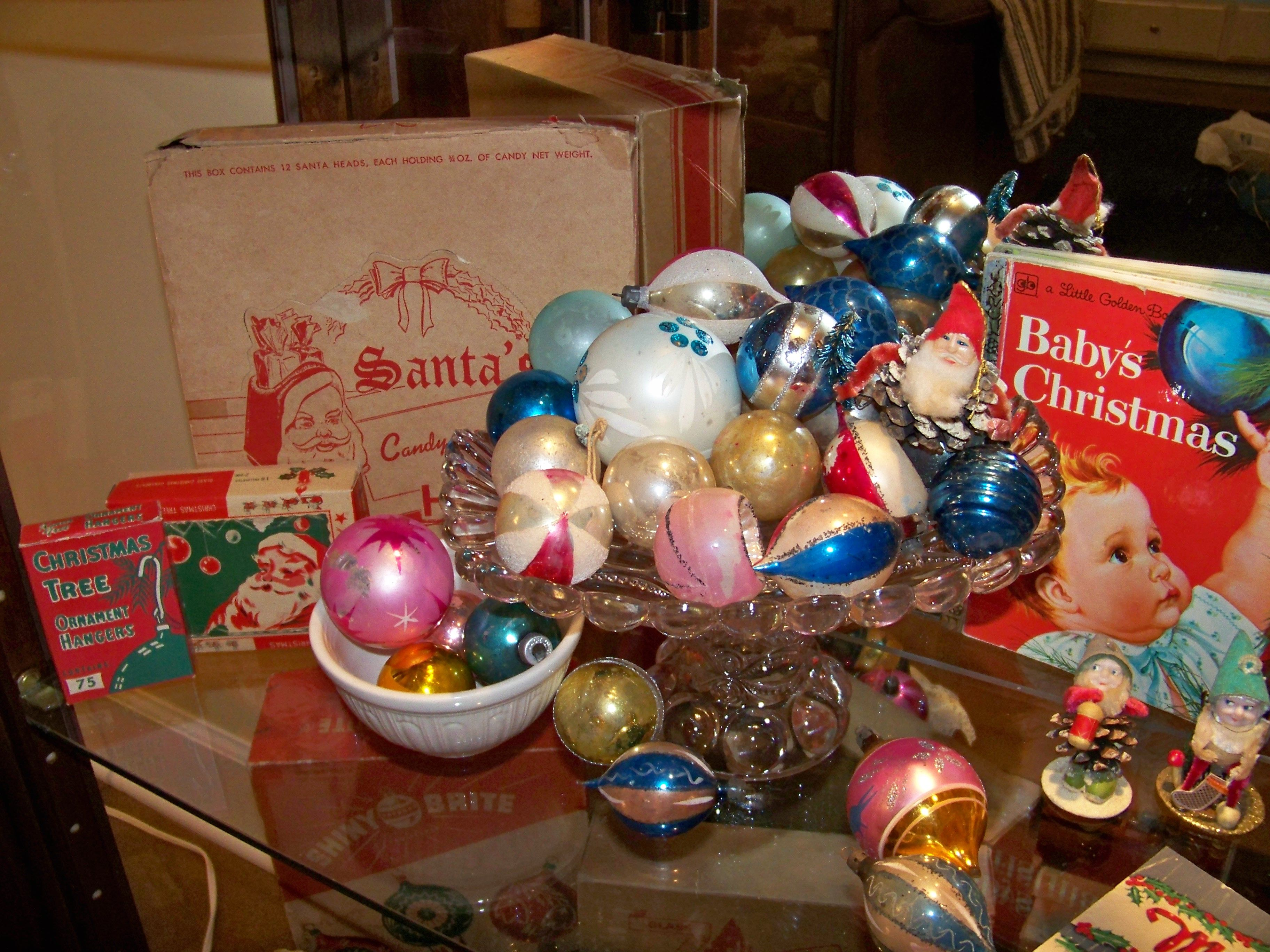 vintage christmas ornaments set out of one of my antique pedestal cake plates.