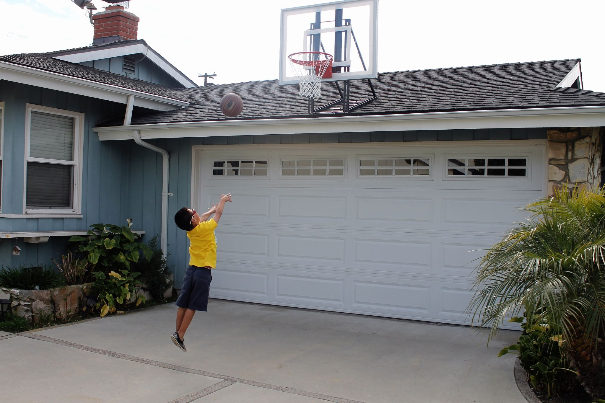 The Roof King Gold basketball hoop is mounted to a typical looking ...