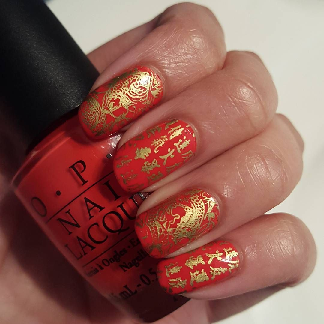 """Belated Chinese New Year nails. Base is @opi_products Tasmanian Devil Made Me Do It and stamped using @uberchicbeauty Far East plate and Mundo de Uñas…"""
