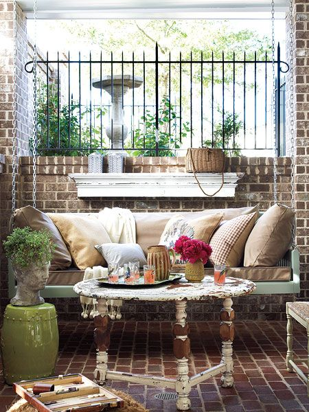 An extra-long bed swing invites lounging on the terrace of this Senoia, Georgia home.  Myhomeideas.com