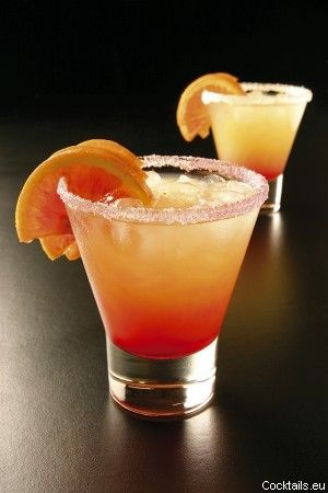 Tequila Sunrise, with tequila, orange juice and grenadine syrup.