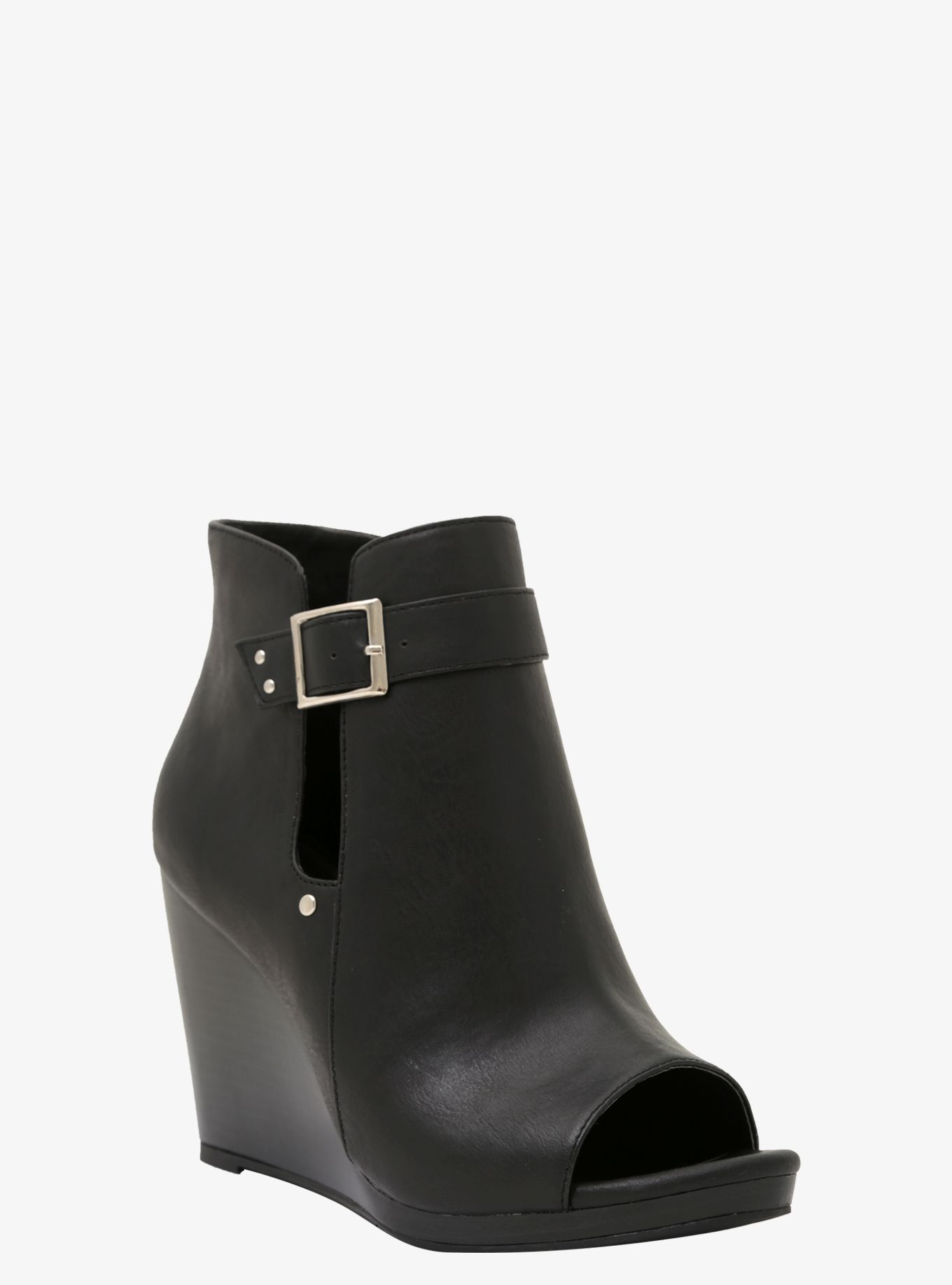 1c2d967a49d2 Fall in love with our Peep-Toe Wedge Bootie...  sigh