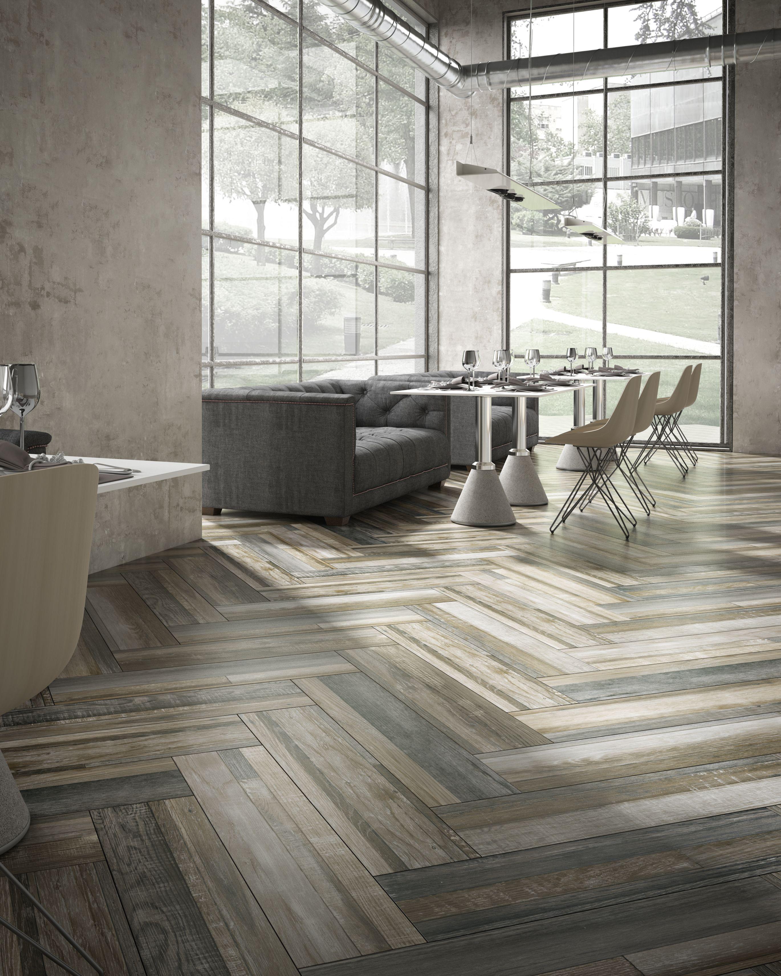 Floor tile that imitates worn vintage wood with a combination of floor tile that imitates worn vintage wood with a combination of different sizes and shades dailygadgetfo Choice Image