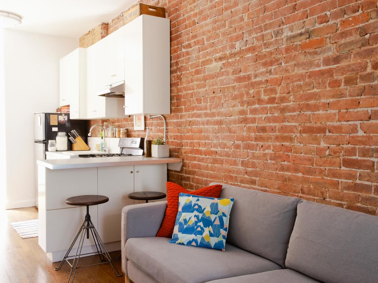 This Contemporary Living Space Goes Bold With A Raw Brick Wall Paired With  A Casual Gray
