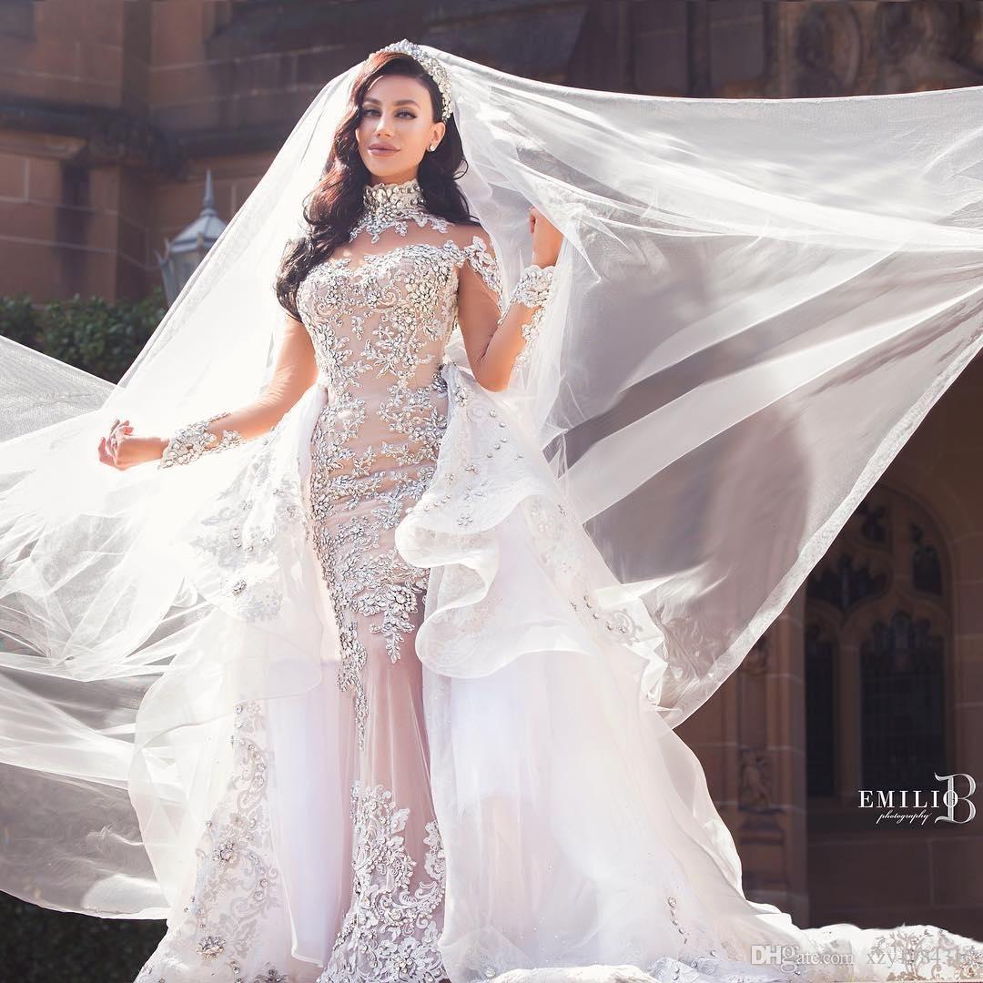 Luxurious Rhinestone Crystal Wedding Dress High Neck Beads Applique Long Sleeves Mermaid Bridal Dress Gorgeous Dubai Wedding Gown Overskirt From Xzy1984316 32 Crystal Wedding Dresses Glamourous Wedding Dress Sheer Wedding Dress [ 1080 x 1080 Pixel ]