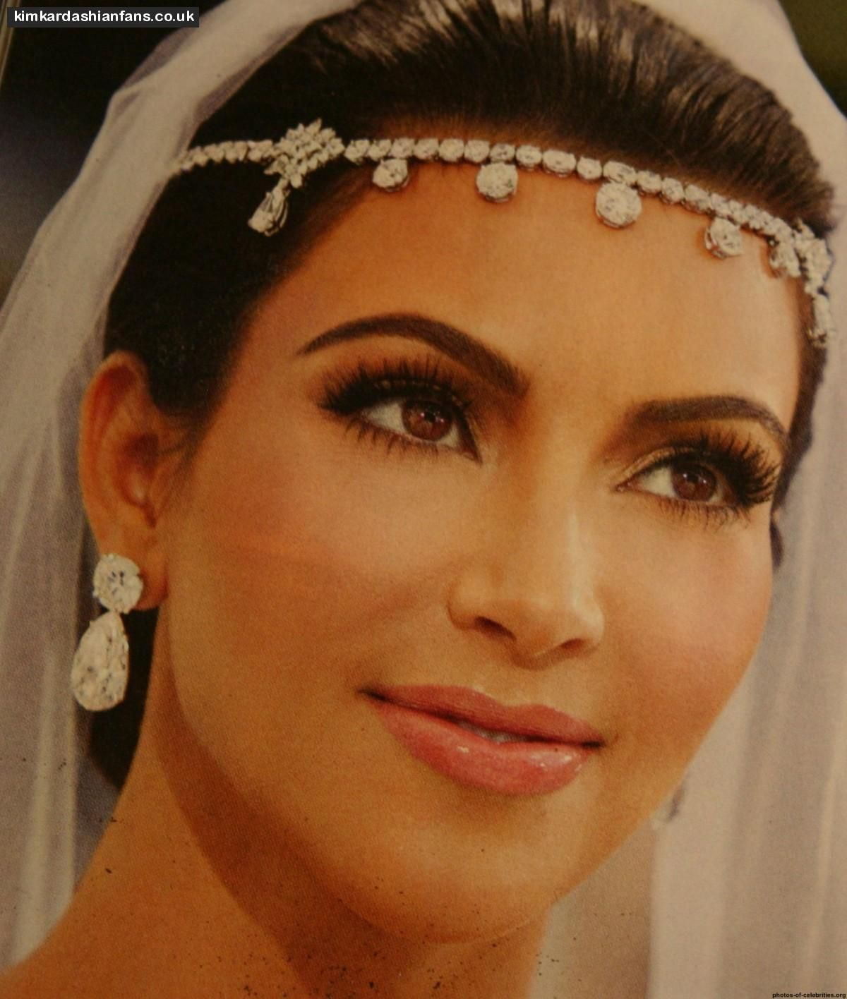 LOVE the earrings...pretty makeup...HATE the head piece