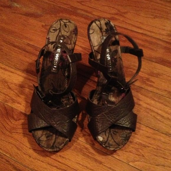 Nine West T-Strap Sandals Nine West T-Strap Sandals. Dark Floral fabric, dark brown leather straps, wooden heel. About 2.5-3 inch heel. Worn once and in perfect condition! Nine West Shoes Sandals