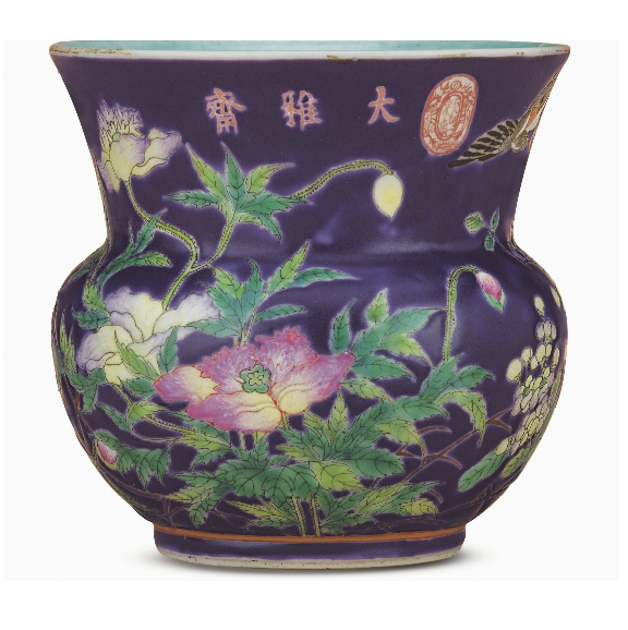 A PURPLE-GROUND FAMILLE ROSE LEYS JAR, ZHADOU GUANGXU PERIOD (1875-1908) The compressed globular body rising from a low foot to a flared mouth, decorated in the famille rose palette with a bird in flight amidst tree peonies and hydrangea sprays, inscribed in iron-red below the rim Dayazhai, and with Tian Di Yi Jia Chun sealmark, all reserved on violet ground, with gilt borders encircling the mouth rim and above the ring foot, the interior applied evenly with a light turquoise enamel