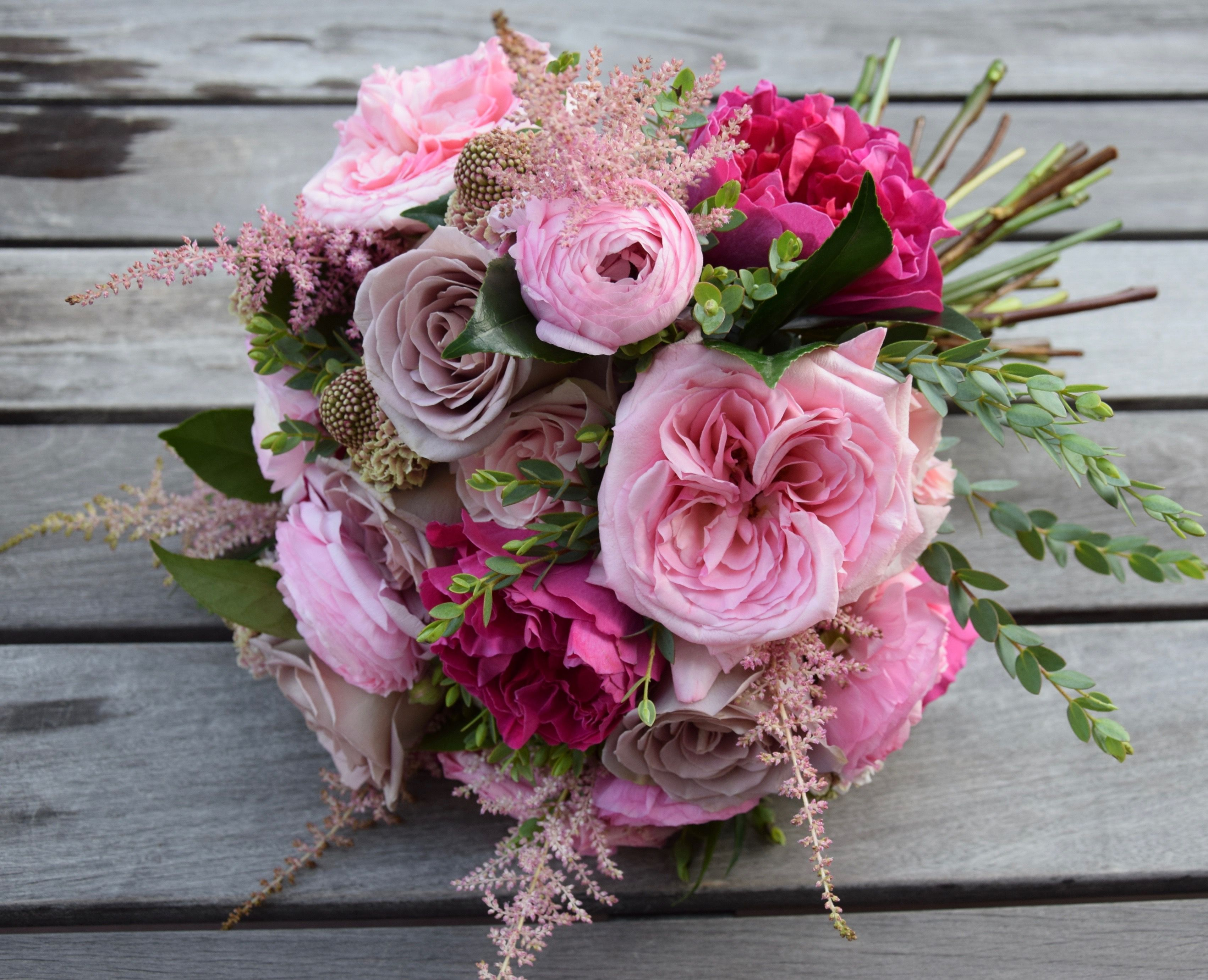 Bridal bouquet with hot pink and soft pink garden roses,  ranunculus, astilbe, amnesia and pink mondial premium roses, scabiosa and greens. #astilbebouquet Bridal bouquet with hot pink and soft pink garden roses,  ranunculus, astilbe, amnesia and pink mondial premium roses, scabiosa and greens. #astilbebouquet