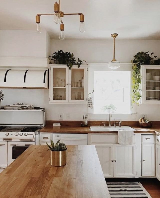 White Kitchen With Butcher Block Countertops And Retro Inspired