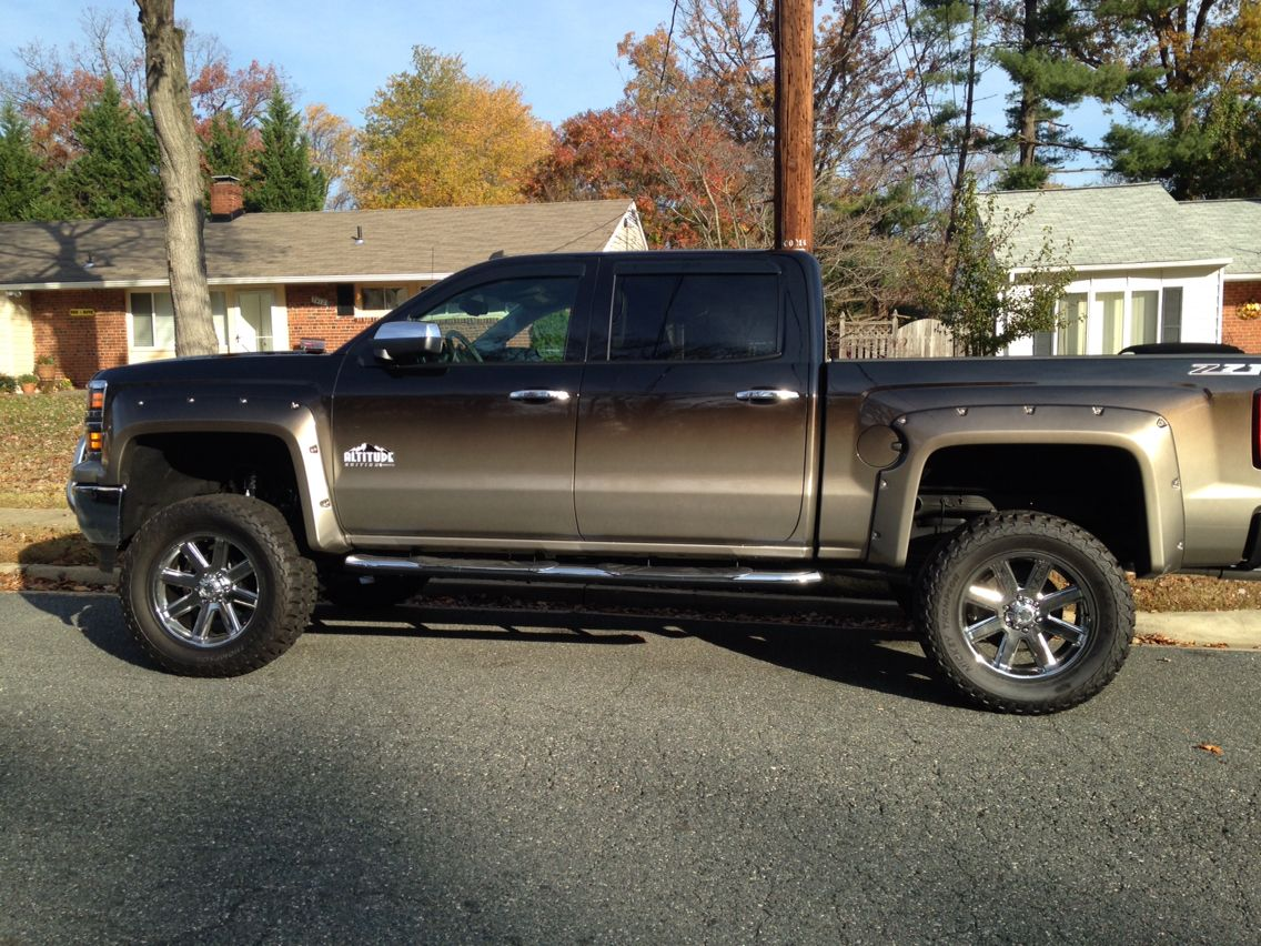 Chevy 2014 silverado 1500 rocky ridge attitude edition with black fading to silver paint
