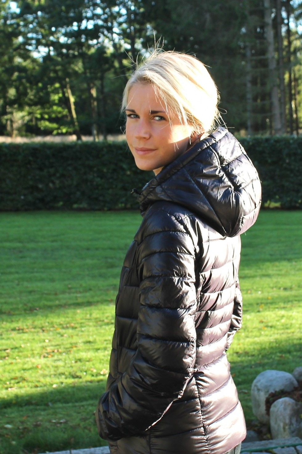 d0677e10780a Blonde woman in sexy down jacket