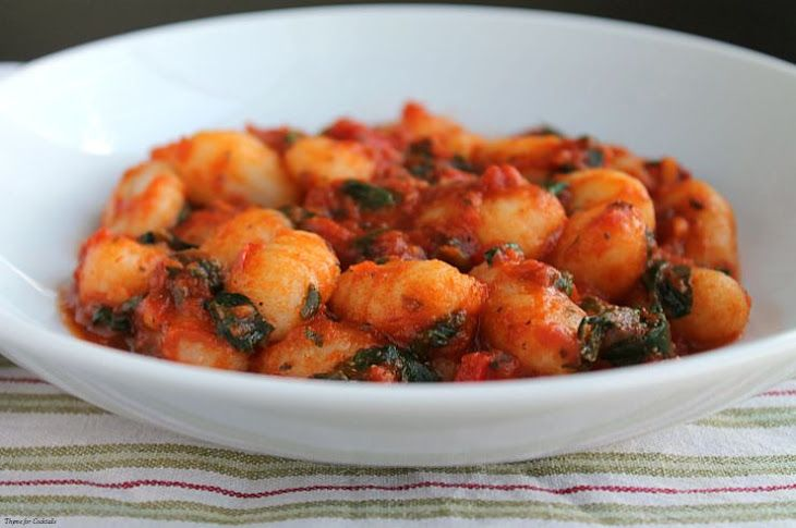 Spinach and Red Pepper Gnocchi Recipe Main Dishes with extra-virgin olive oil, red bell pepper, fresh spinach, red pasta sauce, potato gnocchi