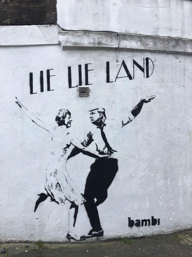 Street artist bambi unveils dancing may and trump mural in london in