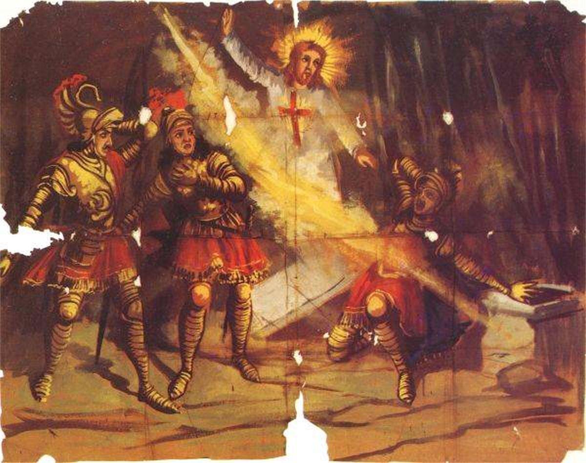 229 Scommessa di Ugiero e Balano che mettono un medaglione pagano e il crocifisso nel braciere. Il medaglione si brucia