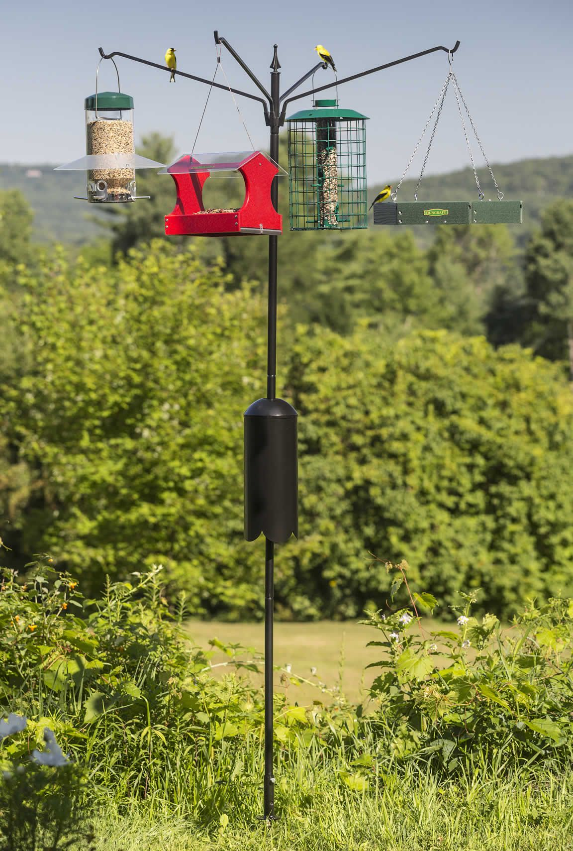 Squirrel-Proof Four Arm Bird Feeding Station: Squirrel-proof feeding station features the widest arm outreach -- perfect for hanging large platforms, baths, hoppers and more. This deluxe solution stands 80 inches above the ground. Each of the four arms holds up to 20 pound and extends 22 inches out to hold the widest feeders!