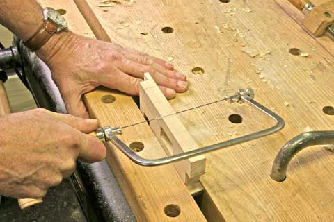 Using a coping saw to cut curves