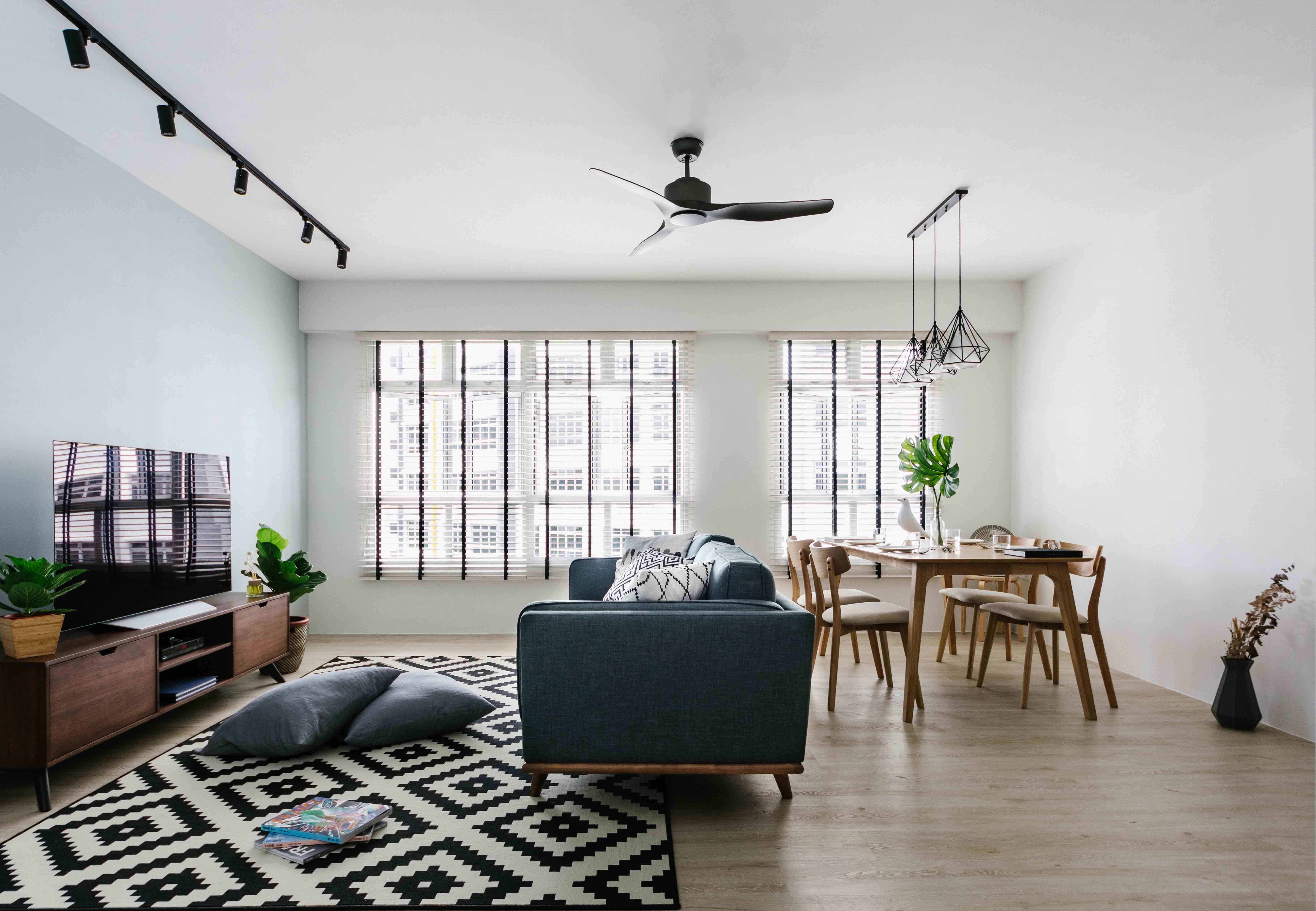 Cool blues and greys bring cosy appeal to this Scandi-style Singaporean home !