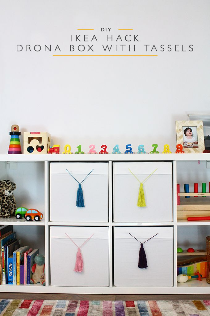 A simple IKEA Hack - add tassels to your plain drona boxes to give them a colourful pop and flair! These IKEA Hack drona boxes with tassels are super easy | Squirrelly Minds