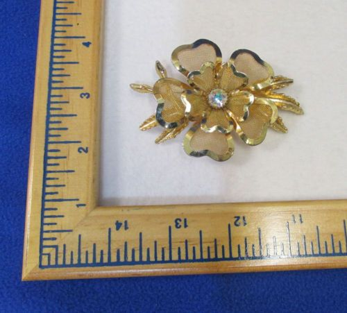 Gorgeous! This Pin Is Made Out Of A Gold Tone Metal With