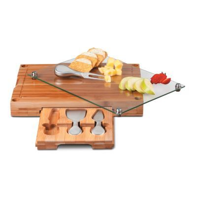The Cutting Board & Cheese Tool Set is an elegant and clever cheese server. The thick bamboo base is a cutting board with a recessed groove to catch juice or crumbs.