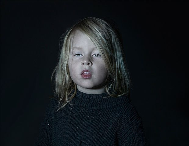 PORTRAITS SHOW THE VACANT STARES OF CHILDREN ENGROSSED IN TV