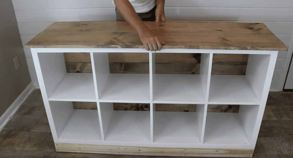 Man demonstrates how to change a piece of IKEA furniture to a beautiful DIY kitchen island