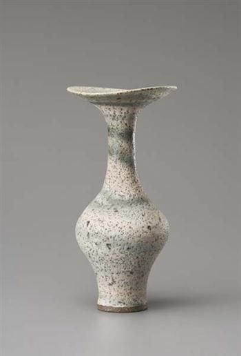 Vase with flaring lip, Mixed clay body combining with glaze resulting in a multi-coloured integral spiral. Mineral elements mixed into the body material producing a pitted, speckled surface. 26 cm. (10 3/4 in.) high, c.1979