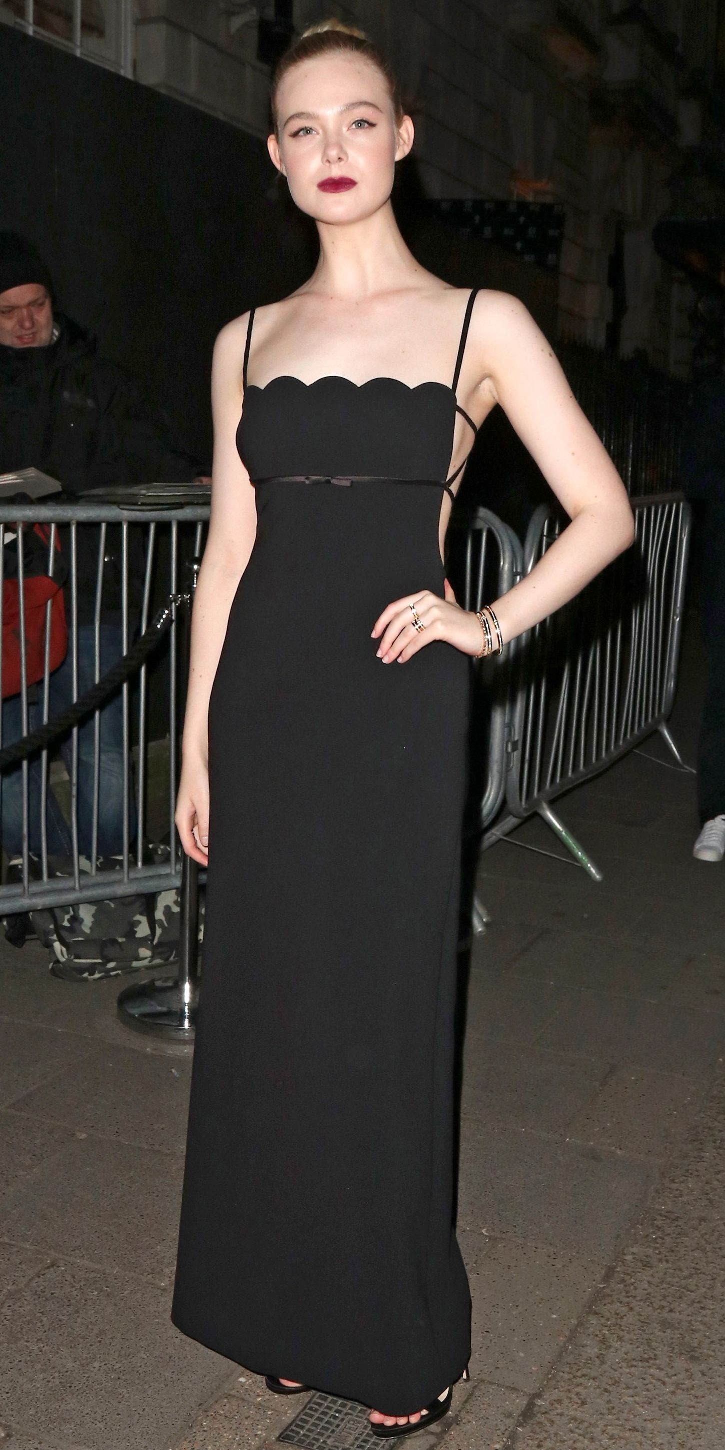 72c1fb58e9dc Elle Fanning's flawless style streak continues. This time, she opted for a  Miu Miu dress with a scallop neckline and Tiffany & Co. jewelry.