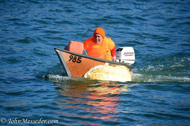 Buzz Pinkham racess a 985-pound Johnson outboard powered pumpkin on the Damariscotta (Maine) River during Pumpkinfest 2014
