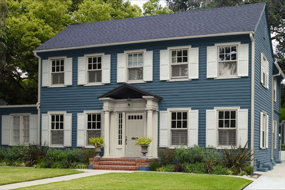 exterior paint behr blue spell hushed white house on behr exterior house paint photos id=54011