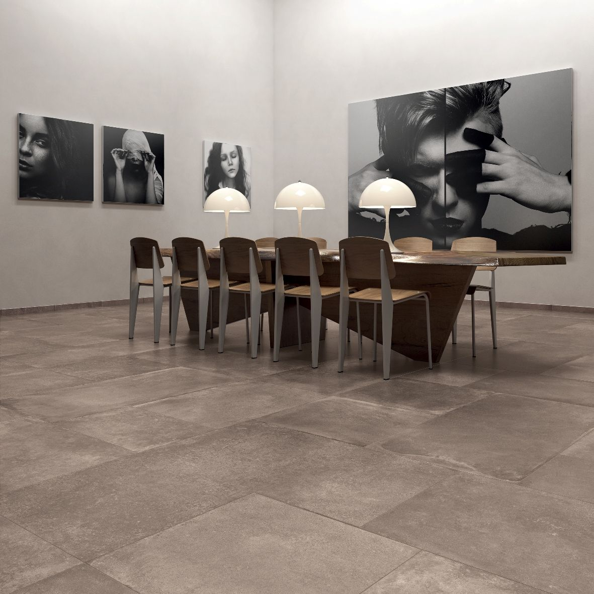 Volutamente minimalista questa galleria d'arte pavimentata con UNIKA di ABK. Il colore Bronze è stato posato mescolando 4 formati (60x60, 60x120, 60x80, 60x40 cm). #abkemozioni #floor #gres #porcellanato #ceramic #tiles #design
