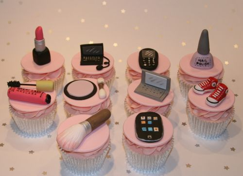 The fondant decorations on these cupcakes made by the Clever Little Cupcake Company are totally awesome!