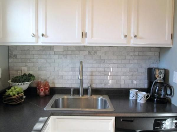 Kitchen Backsplash White Cabinets 2x4 carrara marble tiles, blue-grey paint, charcoal laminate