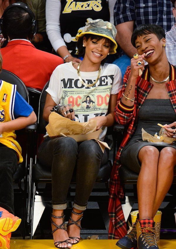 4b088ce70 rihanna-los-angeles-lakers-game -silver-spoon-attire-cameo-camo-bucket-hat-urban-outfitters-acdc-money-talks-tee-olcay-gulsen-chain-embellish.