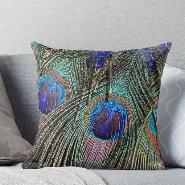 An Artfully Stitched Peacock Feather Spans Our Teal Cotton Pillow