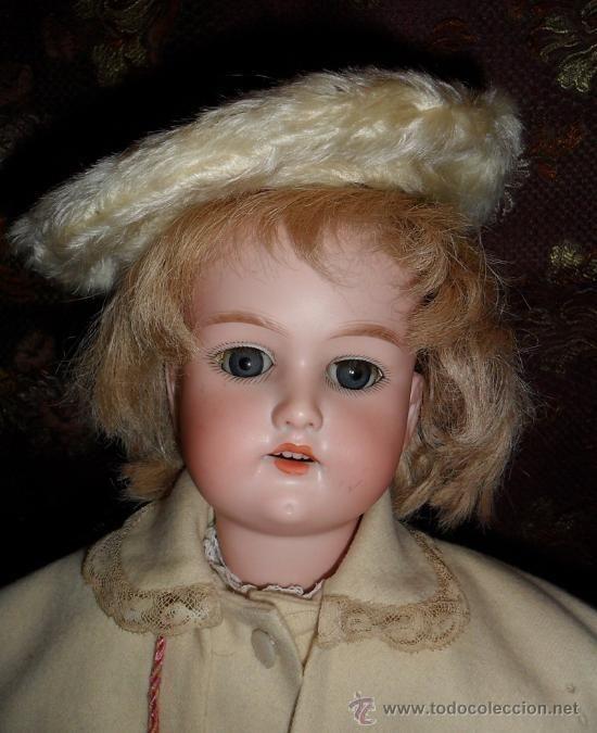 SOLD Muñeca Cuno y Otto Dressel original vestida de invierno All original, impressive beauty! Cuno and Otto dressel bisque doll in winter wear, 50 cm