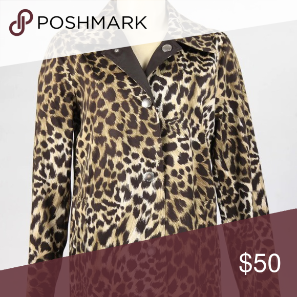 026b438cd516 Michael Kors Reversible Raincoat Gorgeous leopard pattern, with a luxe  brown Reversible side. Michael Kors Jackets & Coats Trench Coats