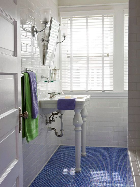 This small bathroom combines white subway tile walls with a sea inspired  floor of Blue Bathroom Design Ideas White tiles Glass mosaic