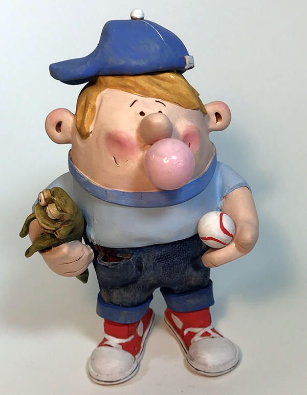 Polymer clay figurine boy blowing bubble gum bubble with ...