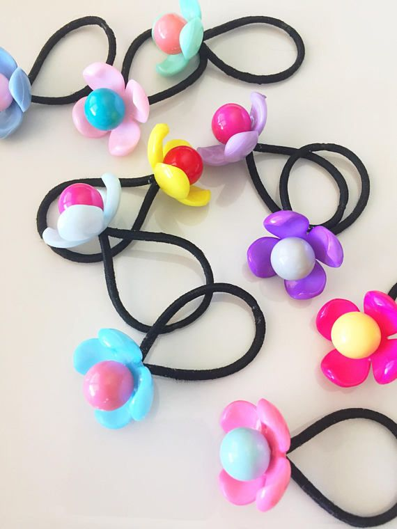 What little girl (or big girl) wouldnt go crazy over these colorful flower  hair f6a587be357