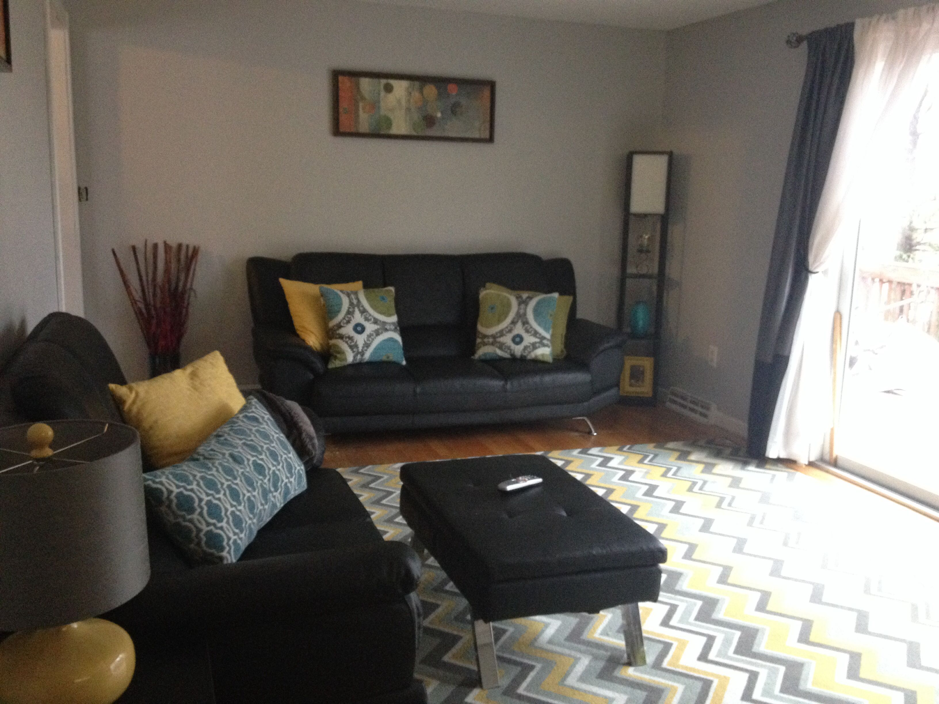 Softening The Look Of Black Couches With Pops Of Color Living Space Decor Home Decor Space Decor #pop #of #color #in #living #room