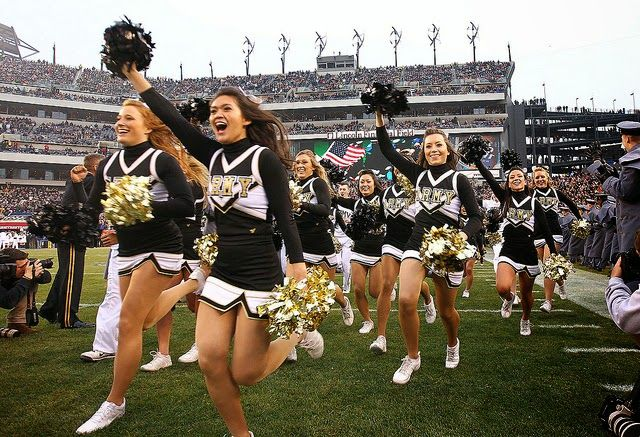 the other paper: Two West Point cheerleaders made out with each oth...