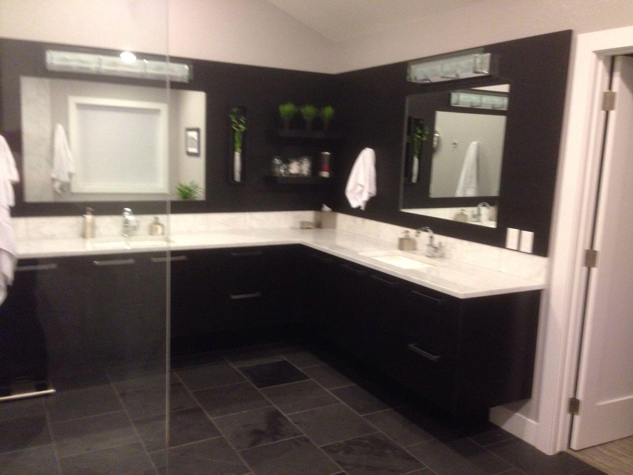 Master bath Ebony stained custom oak cabinets white marble