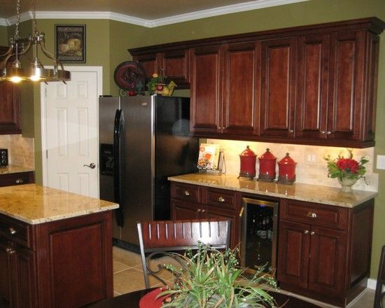 Adorable Traditional Kitchen With Brown Wood Cabinets And Green Olive Wall Paint Color Also
